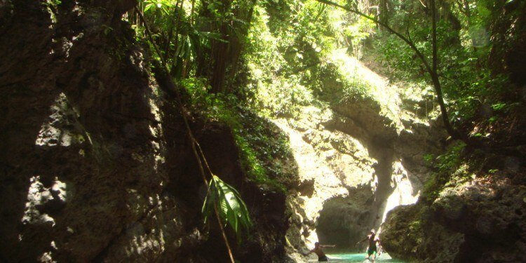 a boat ride can lead to a hidden cave in Jamaica