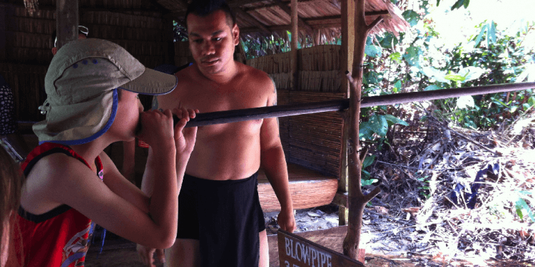shooting a blowdart gun in Borneo