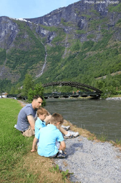 A family admiring the mountain view on a nature walk in the nordic countries.