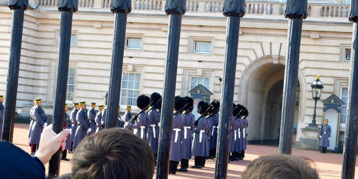 The changing of the guard in front of buckingham palace