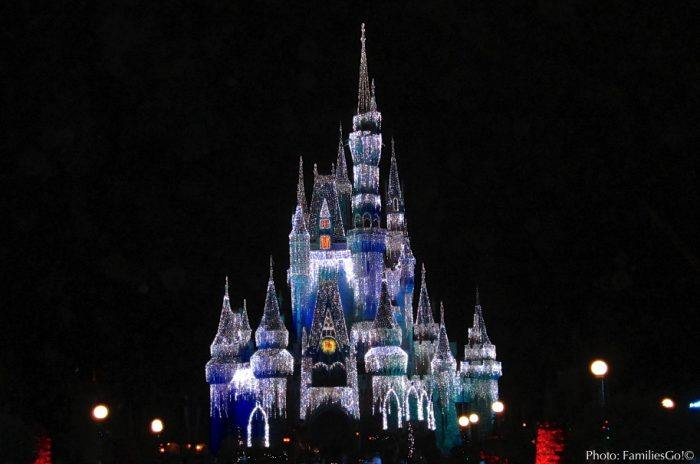 The castle lights up for a disney holiday party