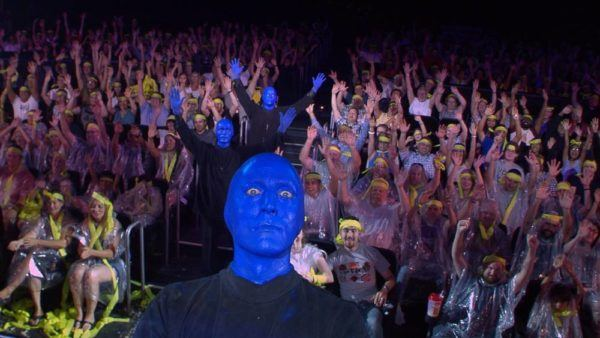 Bue man group takes selfies with the audience at many shows