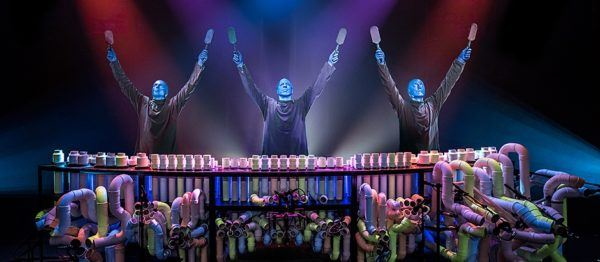 Blue man group is musical. Here they are banging on pipes. Blue man group is musical