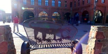 A square in flagstaff has artful benches, skaters and shops