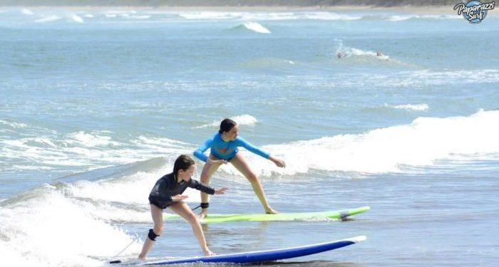 Tweens love taking surfing lessons on tamarindo beach in costa rica