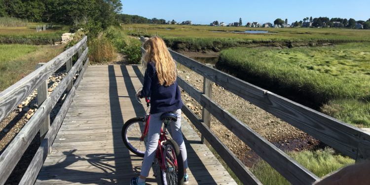 Biking toward the ocean near kennebunk beach, maine