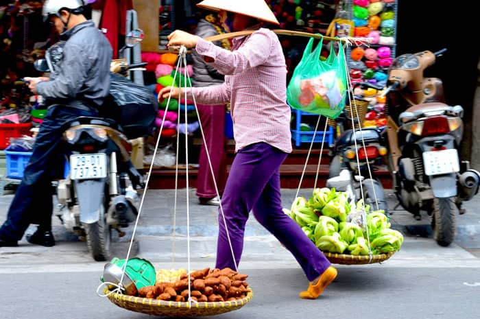 A peddler with her wares in hanoi