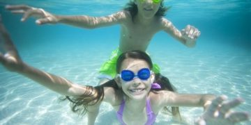 Tweens play in the water on grand bahama island