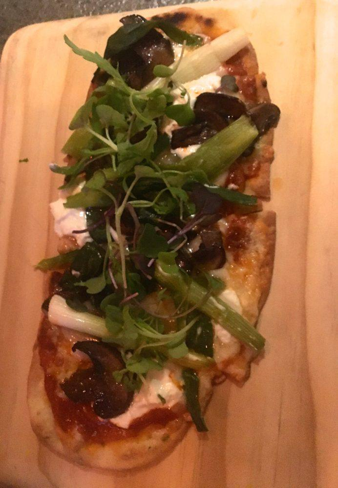 Flatbread with goat cheese, mushrooms and green on top at Nektar, a popular restaurant in New Hope, PA