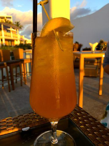 A rum swizzle cocktail at sunset  at the 1609 restaurant in hamilton, bermuda