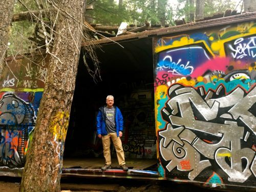 Trees and graffitti co-exist on the train wreck trail in b. C.