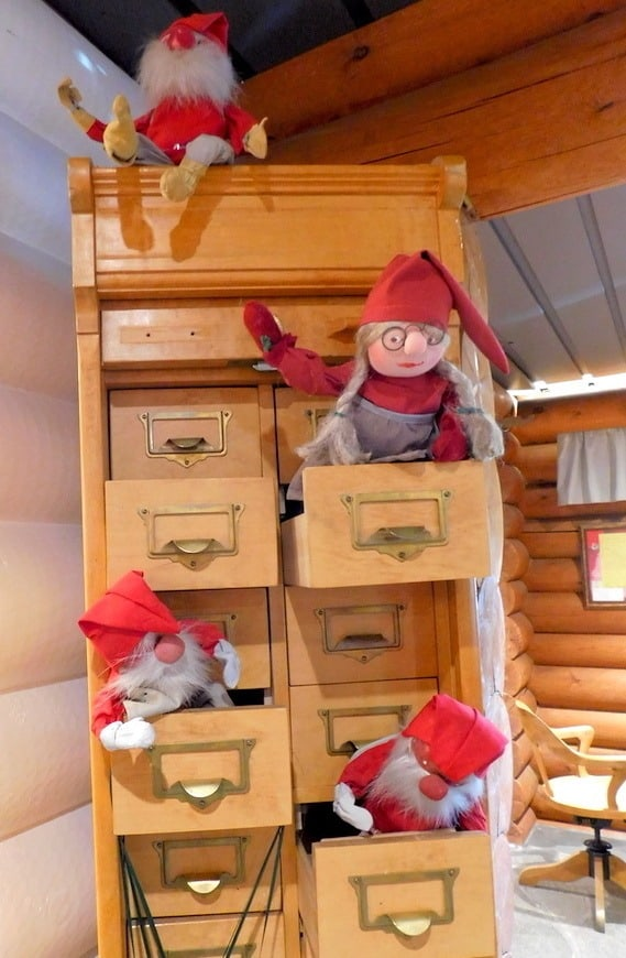 tiny elves keeping busy at Santa's Post office at the Arctic Circle