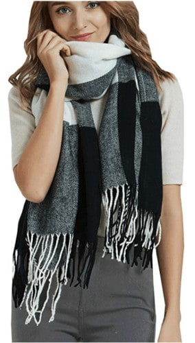 A large warm scarf like this black and white one can come in very handy when you're traveling.
