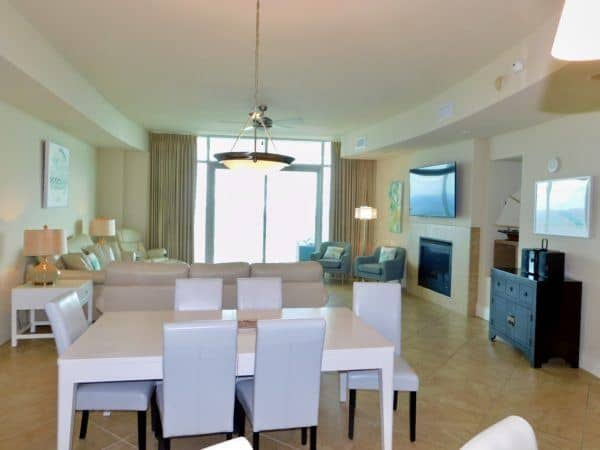 The living and dining area of a spacious gulf shores condo