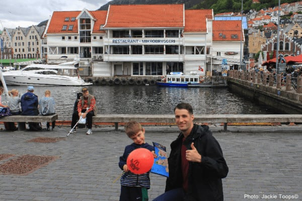 A map and a balloon. This father and son mix familiar and new while exploring bergen as a port of call.