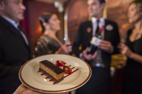 Elegant desserts with wine to match are part of the dining experience of remy a disney cruise lines restaurant.