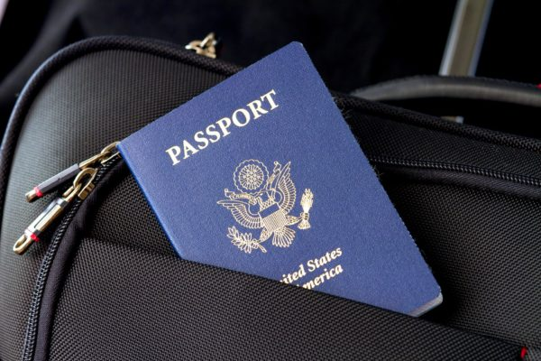 Passport in a luggage pocket. Keep your passport safe when you travel.