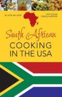 The cover of south african cooking in the usa features the national flag and typical dishes.