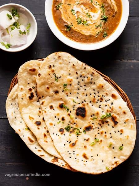 Indian naan alongside curry and onions.
