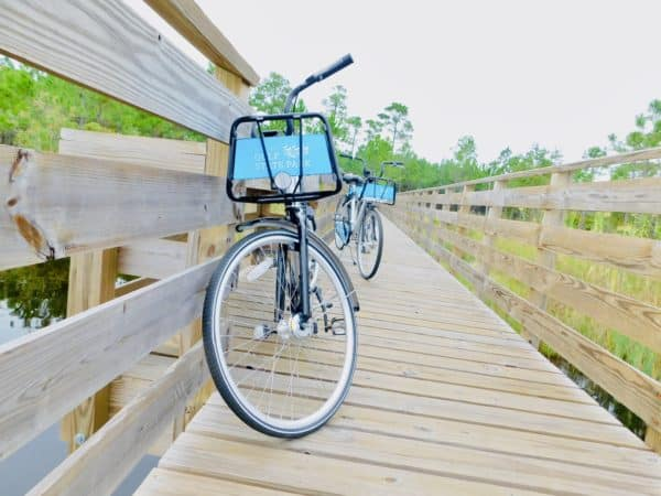 Free borrowed bikes on a wooden board walk in Gulf Shores State Park