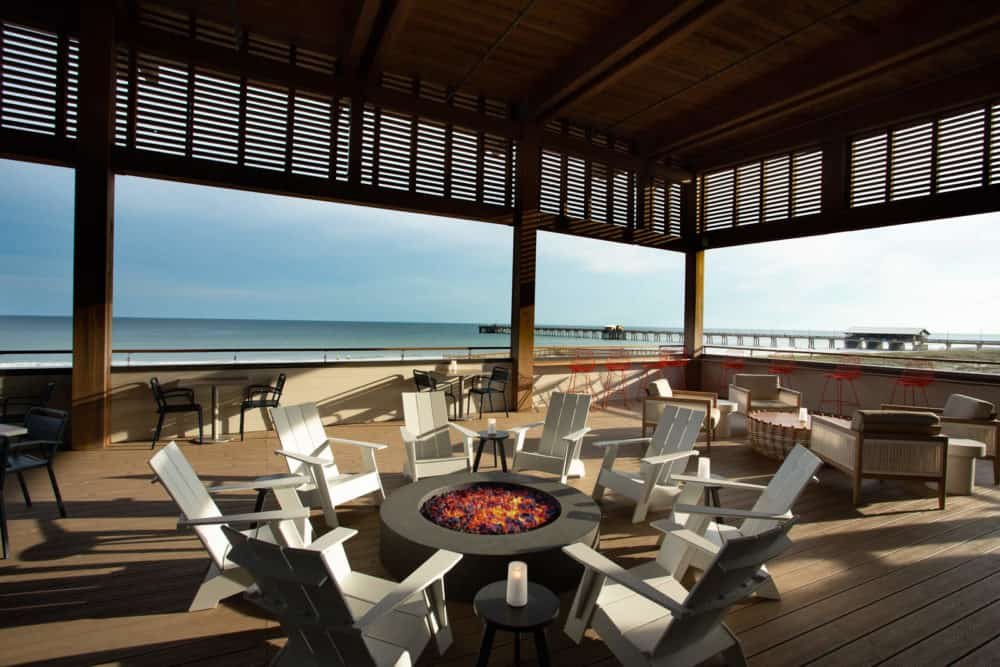 The expansive beach front deck with a fire pit at the Lodge at Gulf State Park.
