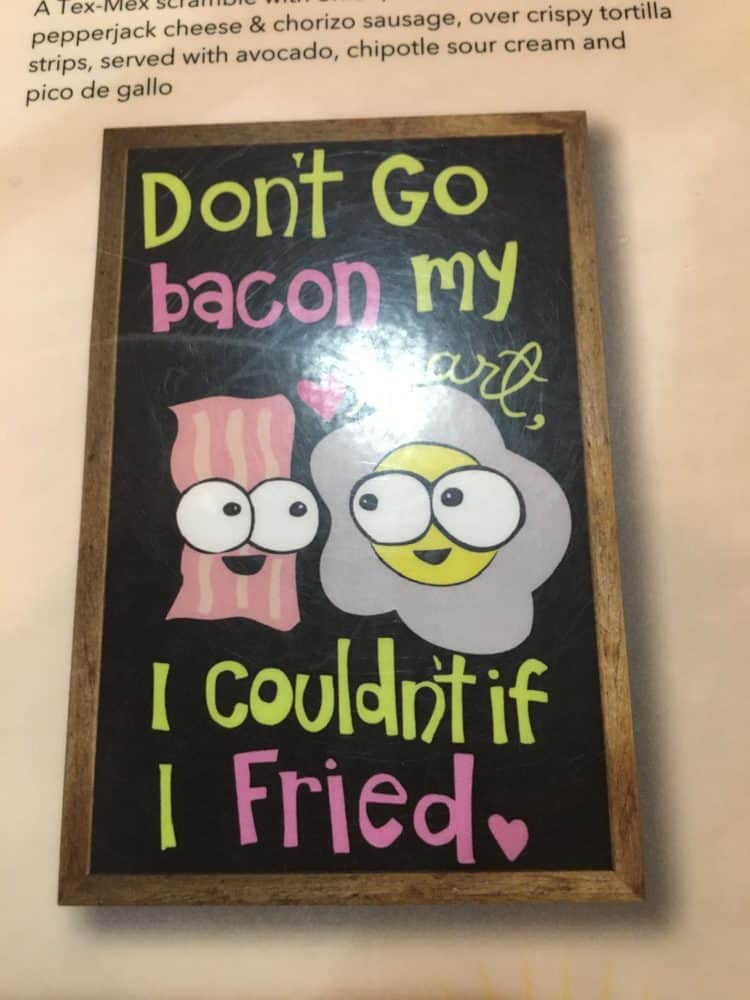 a punny sign about bacon and eggs at Ruby Slipper