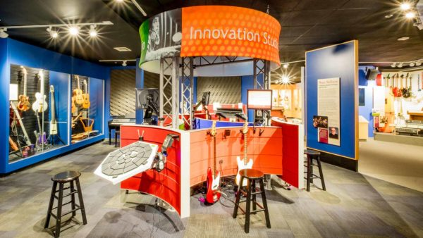 An interactive station at san diego's museum of making music offers tools and instruments for making music.