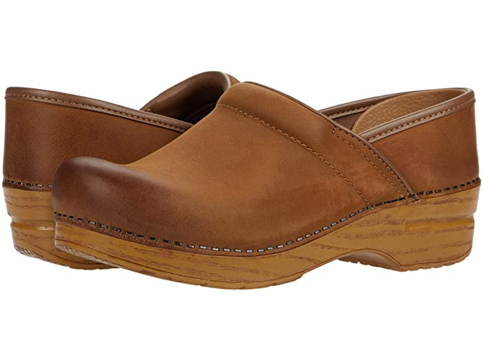 Brown dansko professional clogs keep feet comfortable and look good with jeans when fall rolls around.