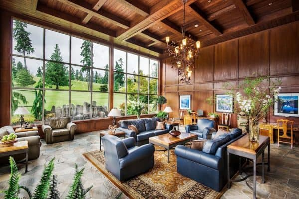 The large, comfortable lobby with a glass wall facing the golf course at olympic lodge in port angeles