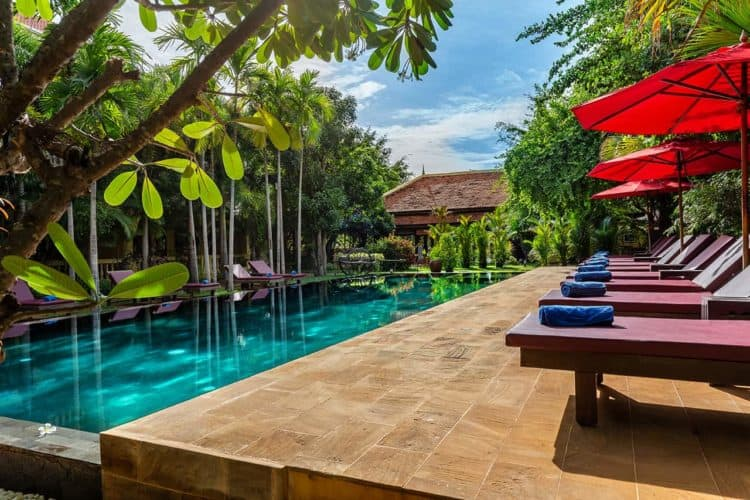 The long pool and secluded deck at the pavilion d'orient in siem reap