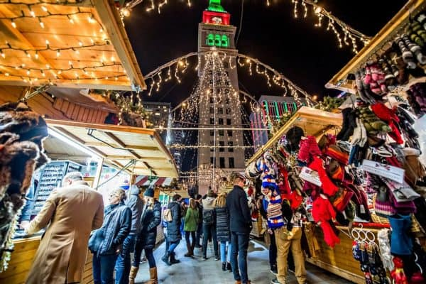 The denver christmas market features german food, american sweets, and a variety of vendors, all below the city's holiday lights.