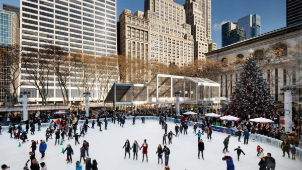 The ice skating rink and winter village shops in bryant park, next to the ny public library.